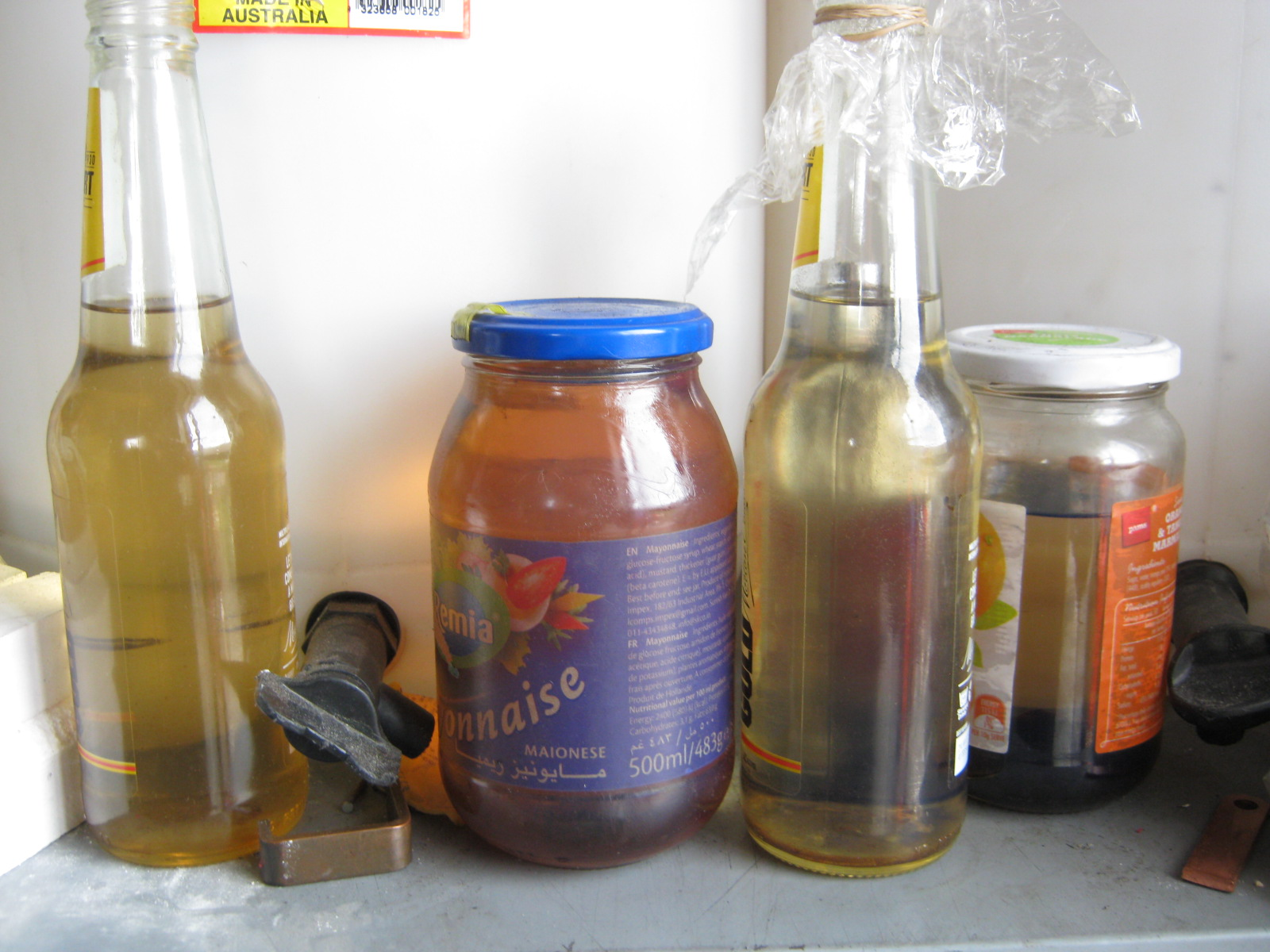 samples of diesel fuel made out of different waste oils